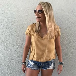 yellow and white stripped t shirt!